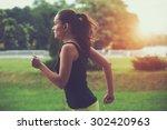 Pretty Sporty Woman Jogging At...