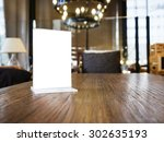 mock up menu frame on table... | Shutterstock . vector #302635193