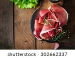 Slices Of Prosciutto On Old...