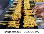 grilled spices pork  satay in... | Shutterstock . vector #302703497