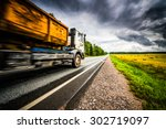 truck driving on a rural road.... | Shutterstock . vector #302719097
