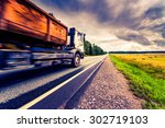 truck driving on a rural road.... | Shutterstock . vector #302719103