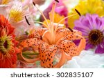 Tiger Lily And Flowers In...