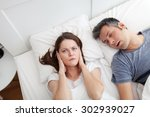 woman covering ears  annoyed by ... | Shutterstock . vector #302939027