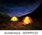 illuminated yellow camping tent ... | Shutterstock . vector #302999123