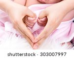 baby  holding mother making... | Shutterstock . vector #303007997