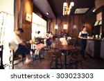 Small photo of Coffee shop - cafe blurred background with bokeh image