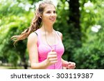 Smiling woman jogging in a park