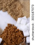 Small photo of Different types of sugar including white, brown, dark brown, demerara, coffee sugar crystals and sugar cubes.