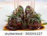 meatball snacks with dark...   Shutterstock . vector #303241127