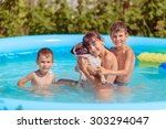 children swim in the pool with ... | Shutterstock . vector #303294047