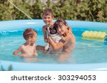 children swim in the pool with... | Shutterstock . vector #303294053