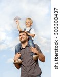 father and son in the park | Shutterstock . vector #303300437