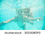 Young Mother Swims Underwater...