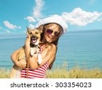 child and dog and sea | Shutterstock . vector #303354023