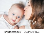 newborn happy baby girl lying... | Shutterstock . vector #303406463