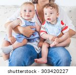 woman holding a baby girl and a ...   Shutterstock . vector #303420227