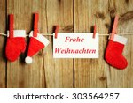 christmas on clothesline with... | Shutterstock . vector #303564257