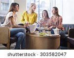youg man having breakfast at a... | Shutterstock . vector #303582047