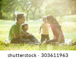 boys with family in the summer... | Shutterstock . vector #303611963