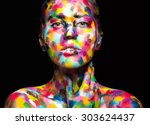 girl with colored face painted. ... | Shutterstock . vector #303624437