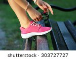 runner girl tying pink shoes on ... | Shutterstock . vector #303727727