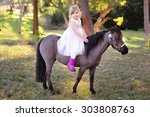 cute little girl and pony in a... | Shutterstock . vector #303808763