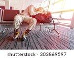 canceled flight.  man sleeping... | Shutterstock . vector #303869597
