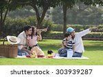family at a picnic | Shutterstock . vector #303939287