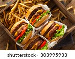 double cheeseburgers and french ... | Shutterstock . vector #303995933