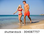 young couple relaxing on the... | Shutterstock . vector #304087757
