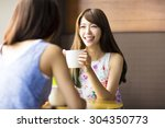 two young woman chatting in a... | Shutterstock . vector #304350773
