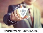 Small photo of Businessman hand press shield security virus web button icon