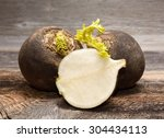 black radish on wooden... | Shutterstock . vector #304434113