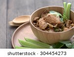 Small photo of Tradition spicy grilled pork salad in Thai Northeastern style named Nam Tok Mho
