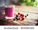 Berry Smoothie On Rustic Woode...
