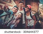 multiracial friends tourists... | Shutterstock . vector #304644377