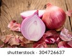 red onions on a wooden... | Shutterstock . vector #304726637