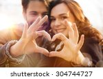 Stock photo closeup of couple making heart shape with hands 304744727