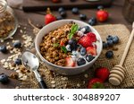 yogurt with baked granola and... | Shutterstock . vector #304889207