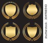 golden shield with laurel wreath | Shutterstock .eps vector #304988543