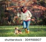 Stock photo woman walk with dog 304988807