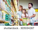 young family in hypermarket... | Shutterstock . vector #305034287