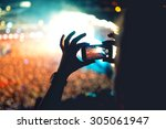 silhouette of a man using... | Shutterstock . vector #305061947