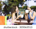 Two Young Woman Chatting In A...