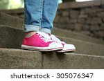 female feet in pink gumshoes on ... | Shutterstock . vector #305076347