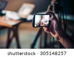 person is taking photo with a... | Shutterstock . vector #305148257