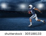 Small photo of American Football Player Running for a touchdown in a large outdoor professional football stadium at night