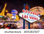 Stock photo welcome to fabulous las vegas nevada sign with blur strip road background 305282507