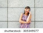 young woman talking on phone by ... | Shutterstock . vector #305349077
